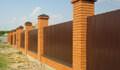 Забор из кирпича и профнастила на фундаменте